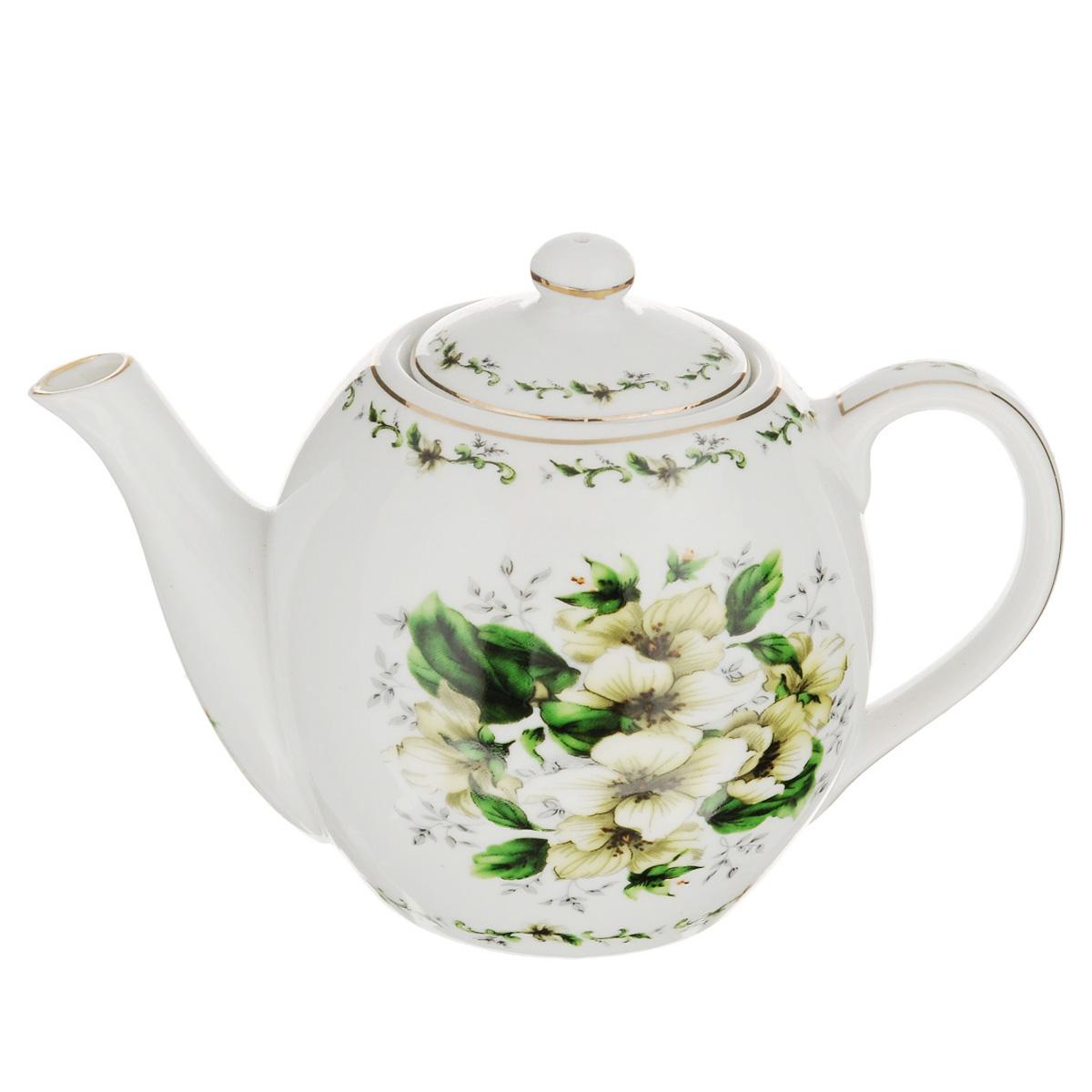 Чайник заварочный Briswild Цветочная грация, 470 мл115510Заварочный чайник Briswild Цветочная грация изготовлен из высококачественного фарфора и покрыт слоем сверкающей глазури. Посуда оформлена изысканным цветочным рисунком и эмалью золотистого цвета. Такой чайник прекрасно дополнит сервировку стола к чаепитию и станет его неизменным атрибутом. Не использовать в микроволновой печи. Объем: 470 мл. Диаметр (по верхнему краю): 6 см. Высота стенки (без учета крышки): 9 см.