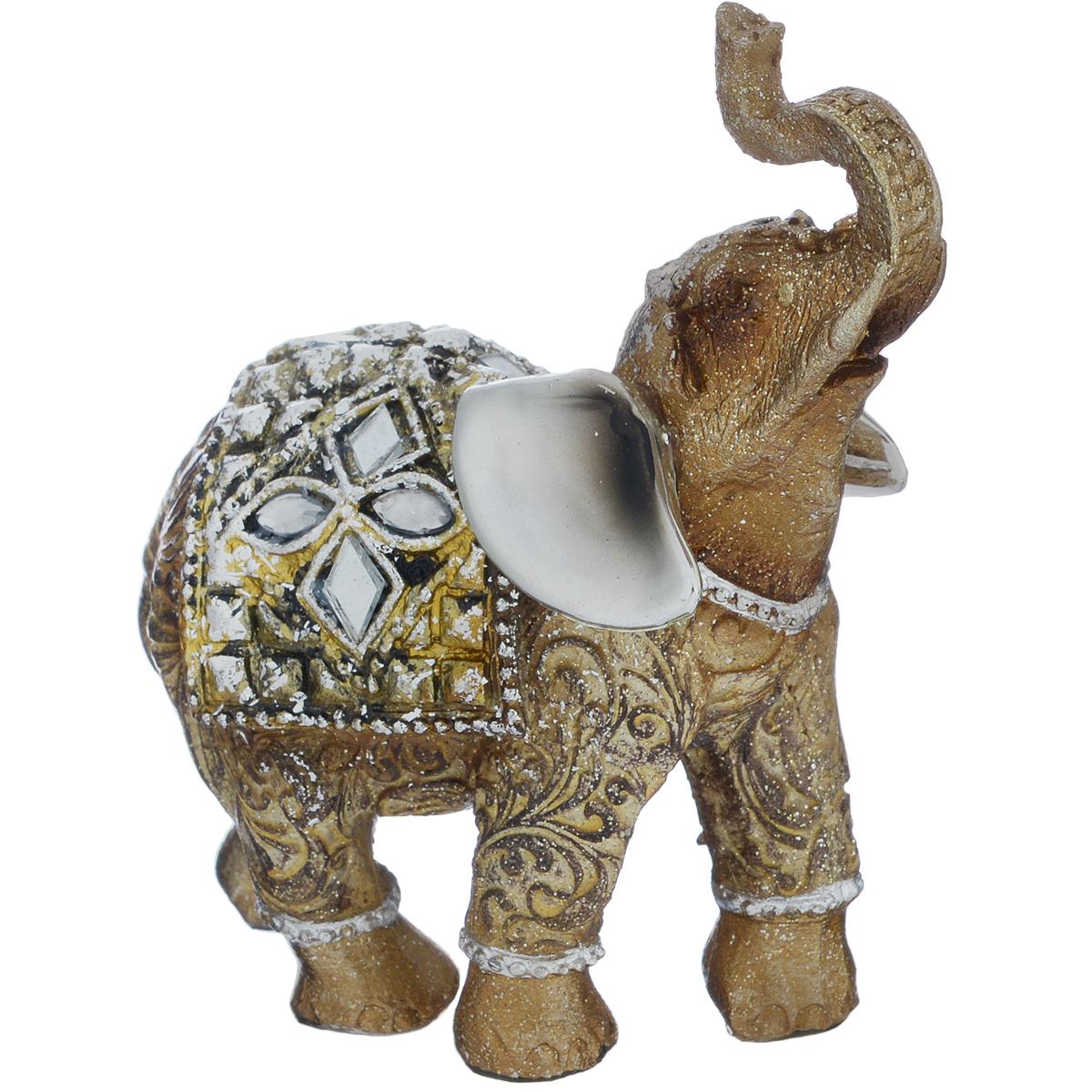 Фигурка декоративная Molento Тайский слон, высота 9,5 см440693Декоративная фигурка Molento Тайский слон, изготовленная из полистоуна, позволит вам украсить интерьер дома, рабочего кабинета или любого другого помещения оригинальным образом. Изделие, выполненное в виде слона, украшено рельефным рисунком, блестками и стразами.Вы можете поставить фигурку в любом месте, где она будет удачно смотреться, и радовать глаз. Кроме того, фигурка Тайский слон станет чудесным сувениром для ваших друзей и близких. Размер фигурки: 8,5 см х 4 см х 9,5 см.
