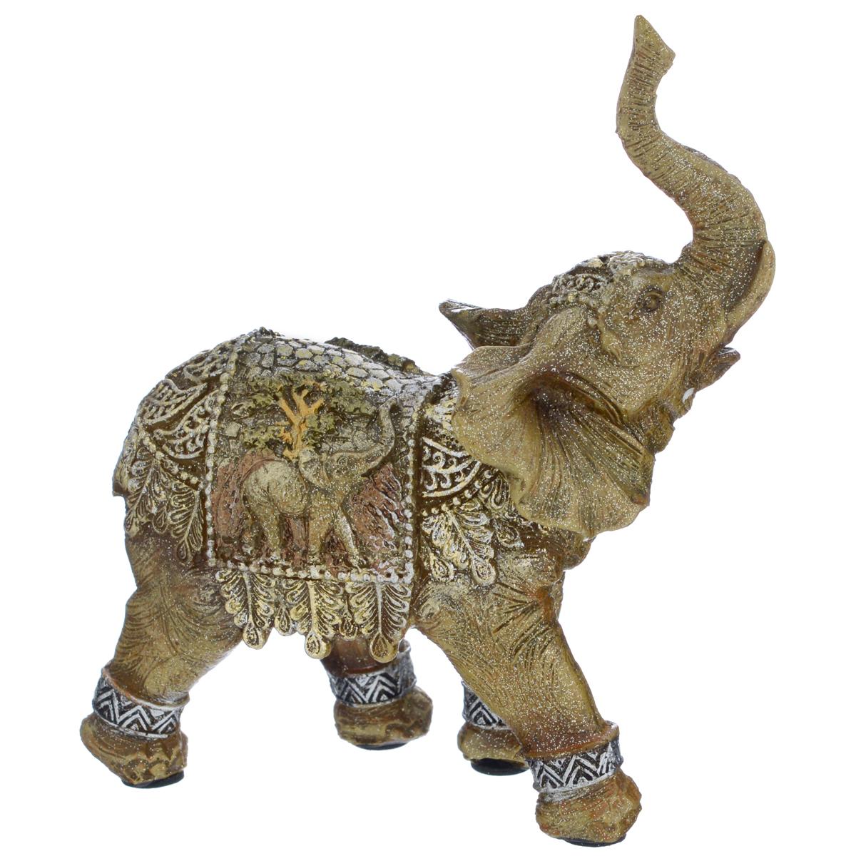 Фигурка декоративная Molento Слон мира, высота 12,5 см695299Декоративная фигура Molento Слон мира, изготовленная из полистоуна, позволит вам украсить интерьер дома, рабочего кабинета или любого другого помещения оригинальным образом. Изделие, выполненное в виде слона, украшено рельефным рисунком и блестками.Вы можете поставить фигурку в любом месте, где она будет удачно смотреться, и радовать глаз. Кроме того, фигурка Слон мира станет чудесным сувениром для ваших друзей и близких. Размер фигурки: 11 см х 5,5 см х 12,5 см.