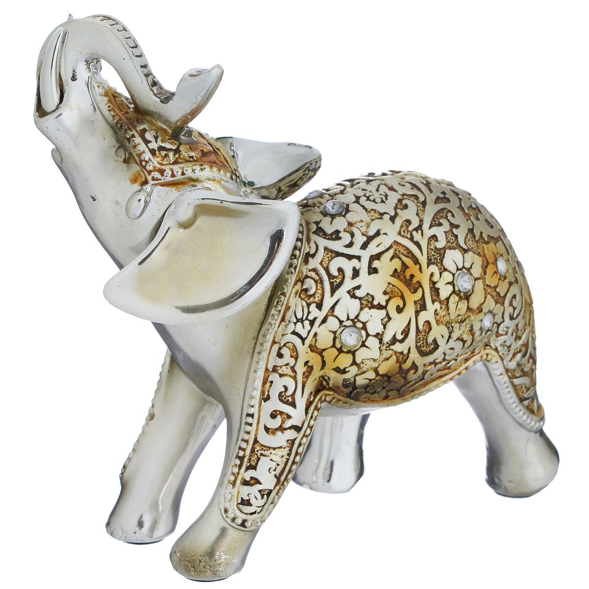 Фигурка декоративная Molento Нарядный слон, высота 11 см74-0060Декоративная фигурка Molento Нарядный слон, изготовленная из полистоуна, выполнена в виде слона и украшена рельефным рисунком и стразами. Такая фигурка станет отличным дополнением к интерьеру.Вы можете поставить фигурку в любом месте, где она будет удачно смотреться, и радовать глаз. Кроме того, фигурка Нарядный слон станет чудесным сувениром для ваших друзей и близких. Размер фигурки: 11,5 см х 5 см х 11 см.