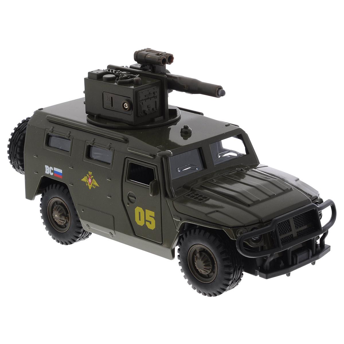 """Машинка ТехноПарк """"ГАЗ """"Тигр"""", выполненная из металла и пластика, станет любимой игрушкой вашего малыша. Игрушка представляет собой военный внедорожник ГАЗ """"Тигр"""", оснащенный открывающимися дверьми, капотом и багажником, а также вращающейся башней с пушкой. При нажатии кнопки на пушке кончик дула начинает светиться, при этом слышны звуки стрельбы и команды """"Огонь! В атаку!"""". Прорезиненные колеса обеспечивают надежное сцепление с любой поверхностью пола. Ваш ребенок будет часами играть с этой машинкой, придумывая различные истории. Порадуйте его таким замечательным подарком! Машинка работает от батареек (товар комплектуется демонстрационными)."""