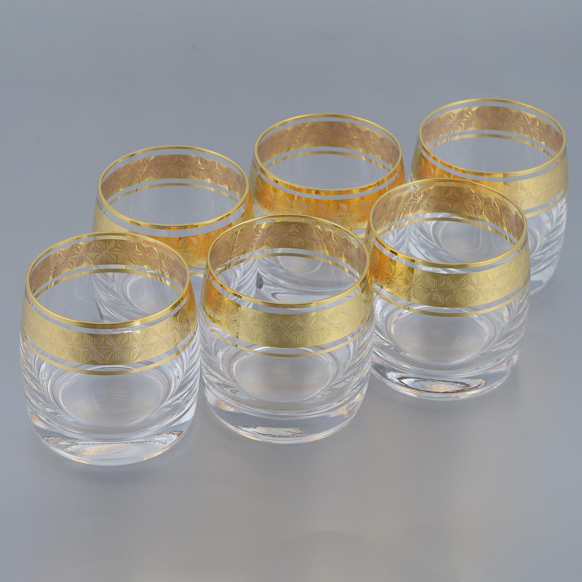 Набор стаканов Bohemia Crystal Ideal, 230 мл, 6 шт080740GНабор Bohemia Crystal Ideal состоит из шести стаканов. Изделия выполнены из высококачественного стекла. Стаканы имеют прозрачную поверхность и декорированы позолоченной окантовкой с орнаментом. Изделия излучают приятный блеск и издают мелодичный звон. Набор стаканов Bohemia Crystal Ideal прекрасно оформит интерьер кабинета или гостиной и станет отличным дополнением бара. Такой набор также станет хорошим подарком к любому случаю. Объем стакана: 230 мл. Диаметр стакана (по верхнему краю): 6,5 см.Высота стакана: 7 см.