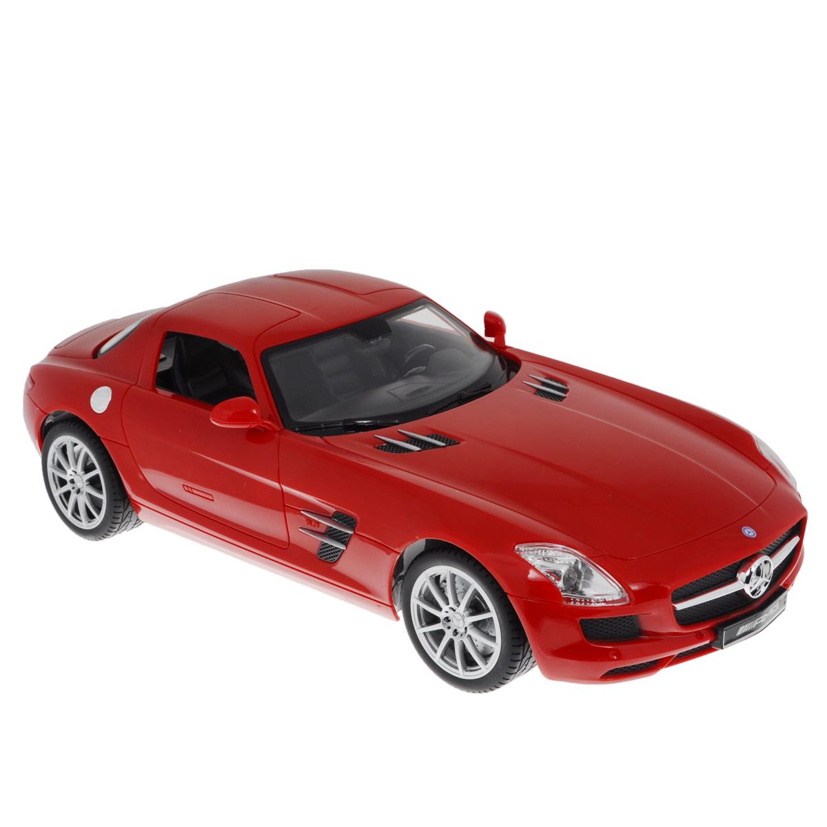 """Все мальчишки любят мощные крутые тачки! Особенно если это дорогие машины известной марки, которые, проезжая по улице, обращают на себя восторженные взгляды пешеходов. Радиоуправляемая модель TopGear """"Mercedes-Benz SLS"""" - это детальная копия существующего автомобиля в масштабе 1:14. Машинка изготовлена из прочного легкого пластика; колеса прорезинены. При движении передние и задние фары машины светятся. При помощи пульта управления автомобиль может перемещаться вперед, дает задний ход, поворачивает влево и вправо, останавливается. Встроенные амортизаторы обеспечивают комфортное движение. В комплект входят машинка, пульт управления, зарядное устройство (время зарядки составляет 4-5 часов), аккумулятор и 2 батарейки. Автомобиль отличается потрясающей маневренностью и динамикой. Ваш ребенок часами будет играть с моделью, устраивая захватывающие гонки. Машина работает от аккумулятора 500 mAh напряжением 6V (входит в комплект). Пульт управления работает..."""
