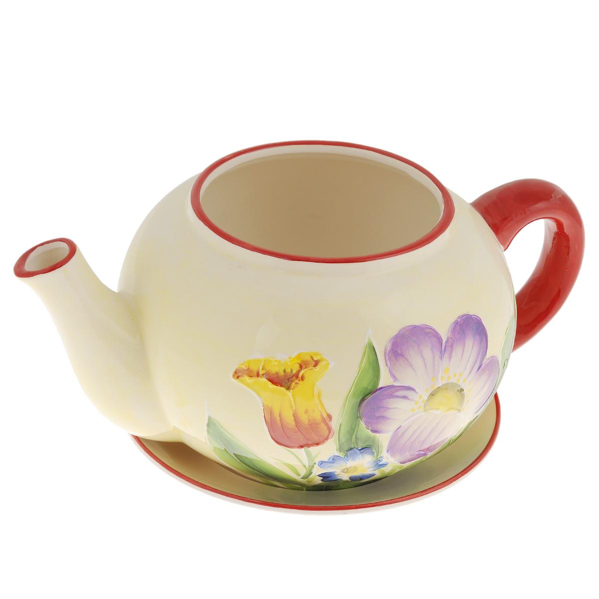 Кашпо Lillo Заварочный чайник, с поддоном. XY10S015-1DMRC102MКашпо-горшок для цветов Lillo Заварочный чайник выполнен из прочной керамики и декорирован красочным рисунком. Изделие предназначено для цветов.Такие изделия часто становятся последним штрихом, который совершенно изменяет интерьер помещения или ландшафтный дизайн сада. Благодаря такому кашпо вы сможете украсить вашу комнату, офис, сад и другие места. Изделие оснащено специальным поддоном - блюдцем.Диаметр кашпо по верхнему краю: 12 см.Высота кашпо (без учета поддона): 14 см.Диаметр поддона: 20,5 см.