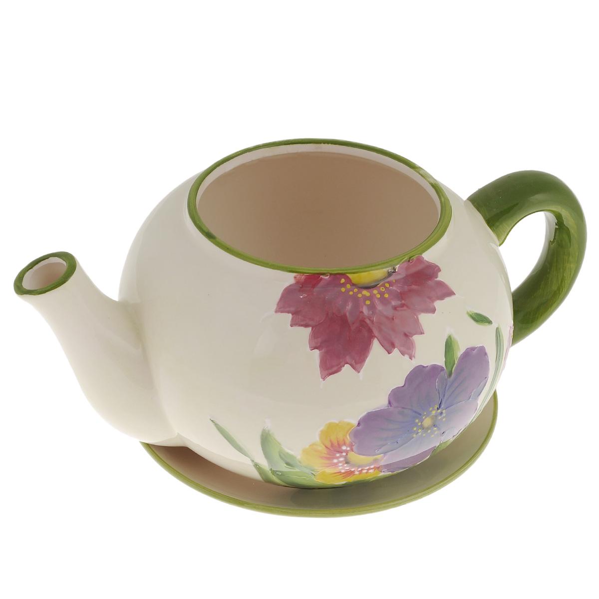 Кашпо Lillo Заварочный чайник, с поддоном. XY10S015-1AXY10S012DКашпо-горшок для цветов Lillo Заварочный чайник выполнен из прочной керамики и декорирован красочным рисунком. Изделие предназначено для цветов.Такие изделия часто становятся последним штрихом, который совершенно изменяет интерьер помещения или ландшафтный дизайн сада. Благодаря такому кашпо вы сможете украсить вашу комнату, офис, сад и другие места. Изделие оснащено специальным поддоном - блюдцем.Диаметр кашпо по верхнему краю: 12 см.Высота кашпо (без учета поддона): 14 см.Диаметр поддона: 20,5 см.