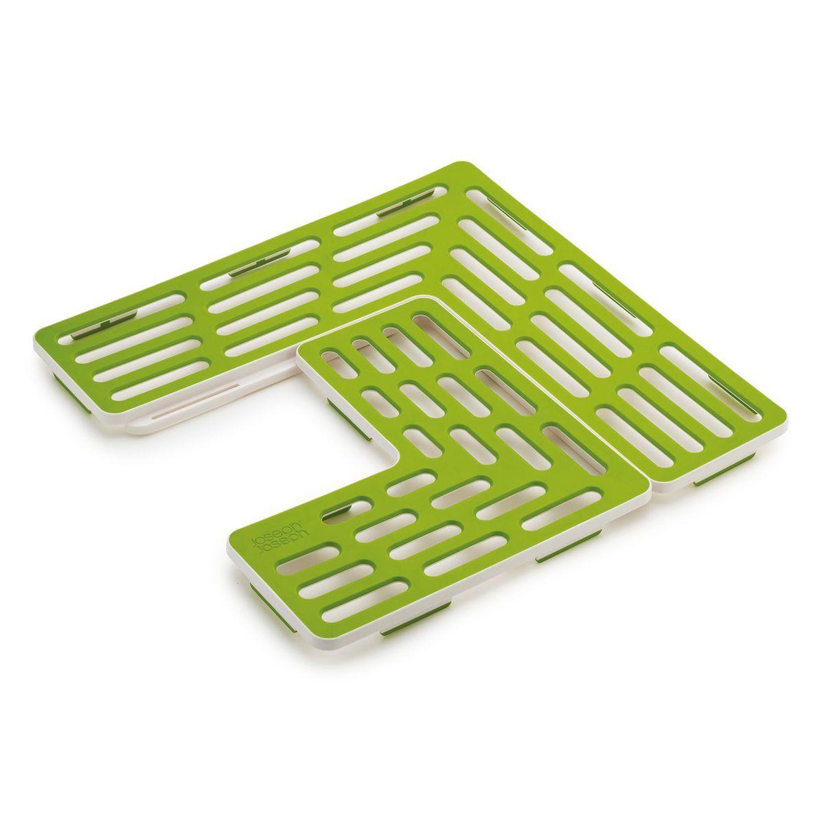 Подложка для раковины Joseph Joseph SinkSaver, цвет: зеленый, белый161250-000Подложка для раковины Joseph Joseph SinkSaver выполнена из термопластичной резины и пластика. Может показаться, что это конструктор, но на самом деле - это подложка, продуманная до мелочей. Она подходит к раковинам разных форматов и адаптируется под сливное отверстие в центре, слева или справа. Прорезиненная поверхность подложки предотвращает повреждение посуды, сколы и царапинки, даже если вы ее уроните. Так же защищена и сама раковина, она всегда будет выглядеть как новая. Минимальный размер раковины: 31 х 31 см. Максимальный размер подложки: 28 см х 28 см.