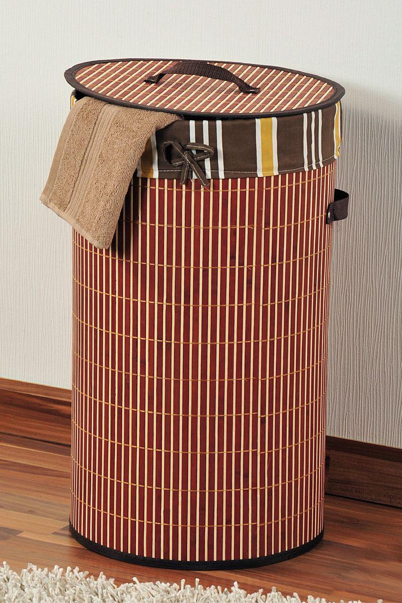 Корзина для белья Kesper, диаметр 35 см531-105Корзина для белья Kesper, выполненная из натурального дерева, предназначена для хранения белья перед стиркой. Корзина очень легко собирается. Внутренний чехол корзины изготовлен из текстиля. Изделие оснащено крышкой и удобными ручками из искусственной кожи. Корзина для белья Kesper - это функциональная и полезная вещь, которая не только сохранит ваше белье, но и стильно украсит интерьер помещения.Диаметр: 35 см.Высота: 60 см.