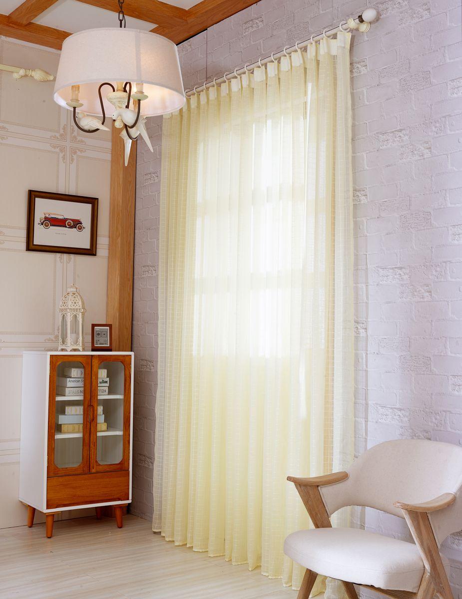 Тюль Zlata Korunka, на ленте, цвет: кремово-желтый, высота 250 см. 20152-53111015175Тюль Zlata Korunka изготовлен из 100% полиэстера и великолепно украсит любое окно. Воздушная ткань и приятная, приглушенная гамма привлекут к себе внимание и органично впишутся в интерьер помещения. Полиэстер - вид ткани, состоящий из полиэфирных волокон. Ткани из полиэстера - легкие, прочные и износостойкие. Такие изделия не требуют специального ухода, не пылятся и почти не мнутся.Крепление к карнизу осуществляется с использованием ленты-тесьмы. Такой тюль идеально оформит интерьер любого помещения.Рекомендации по уходу:- ручная стирка,- можно гладить,- нельзя отбеливать.