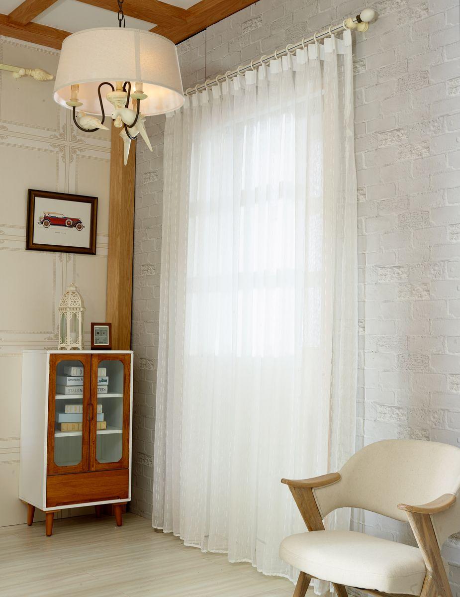 Тюль Zlata Korunka, на ленте, цвет: белый, высота 270 см. 20154-9SVC-300Тюль Zlata Korunka изготовлен из 100% полиэстера и великолепно украсит любое окно. Воздушная ткань и приятная, приглушенная гамма привлекут к себе внимание и органично впишутся в интерьер помещения. Полиэстер - вид ткани, состоящий из полиэфирных волокон. Ткани из полиэстера - легкие, прочные и износостойкие. Такие изделия не требуют специального ухода, не пылятся и почти не мнутся.Крепление к карнизу осуществляется с использованием тесьмы. Такой тюль идеально оформит интерьер любого помещения.
