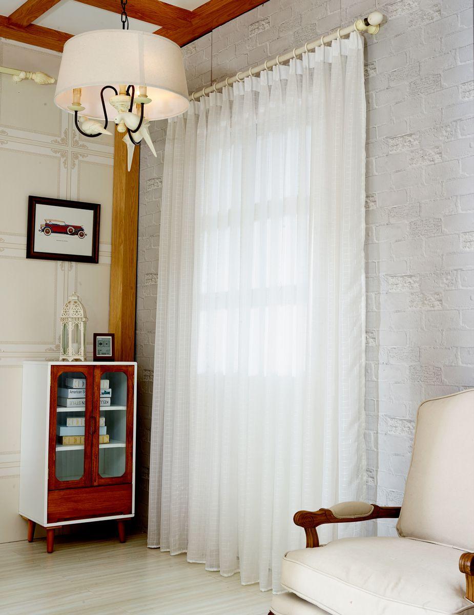 Тюль Zlata Korunka, на ленте, цвет: белый, высота 250 см. 20156-5SVC-300Тюль Zlata Korunka изготовлен из 100% полиэстера и великолепно украсит любое окно. Воздушная ткань и приятная, приглушенная гамма привлекут к себе внимание и органично впишутся в интерьер помещения. Полиэстер - вид ткани, состоящий из полиэфирных волокон. Ткани из полиэстера - легкие, прочные и износостойкие. Такие изделия не требуют специального ухода, не пылятся и почти не мнутся.Крепление к карнизу осуществляется с использованием ленты-тесьмы. Такой тюль идеально оформит интерьер любого помещения.Рекомендации по уходу:- ручная стирка,- можно гладить,- нельзя отбеливать.
