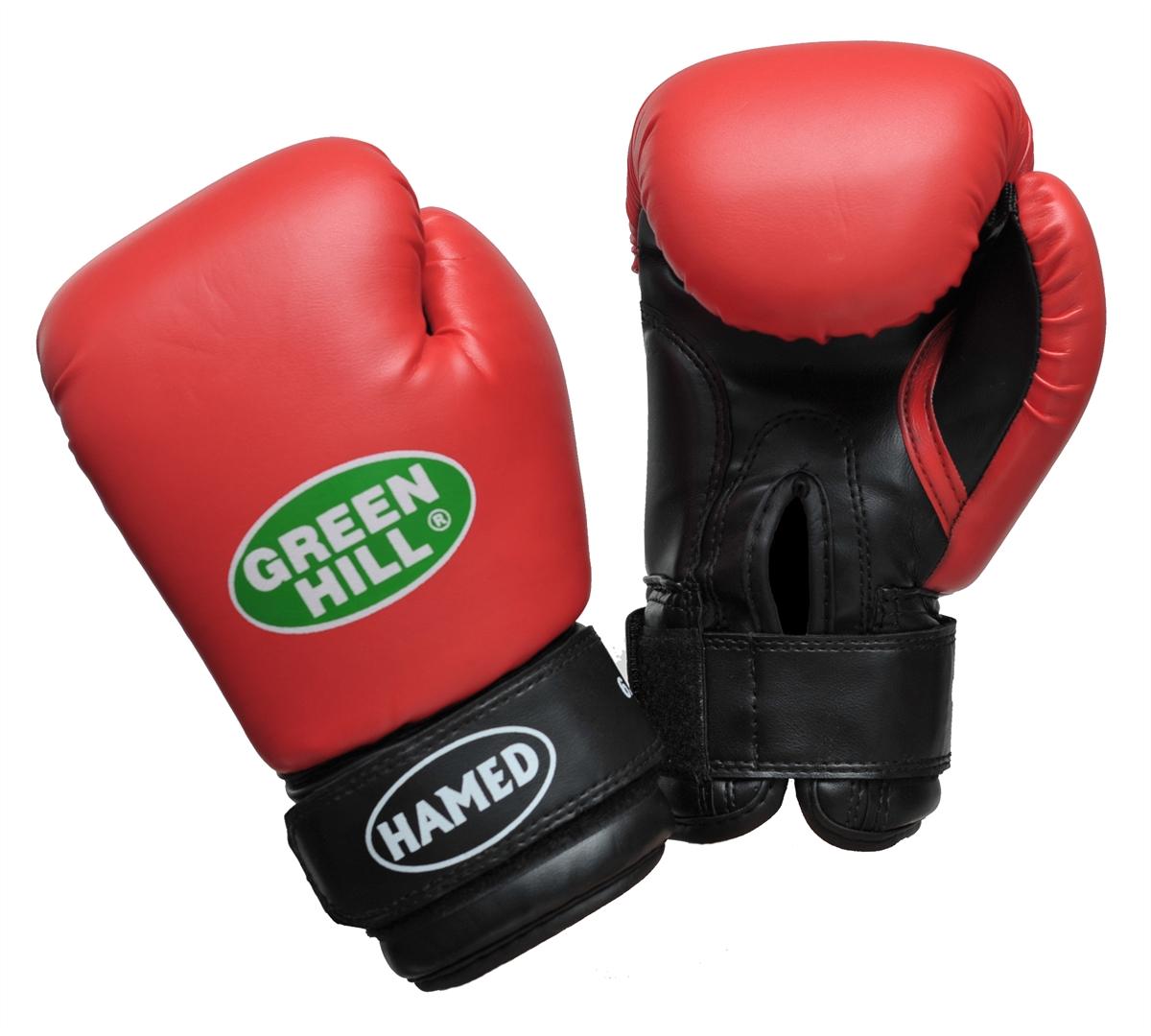 """Детские боксерские перчатки Green Hill """"Hamed"""" прекрасно подойдут для будущих чемпионов. Верх выполнен из искусственной кожи, наполнитель - из пенополиуретана. Перфорированная поверхность в области ладони позволяет создать максимально комфортный терморежим во время занятий. Широкий ремень, охватывая запястье, полностью оборачивается вокруг манжеты, благодаря чему создается дополнительная защита лучезапястного сустава от травмирования. Перчатки прекрасно сидят на руке. Застежка на липучке способствует быстрому и удобному одеванию перчаток, плотно фиксирует перчатки на руке."""