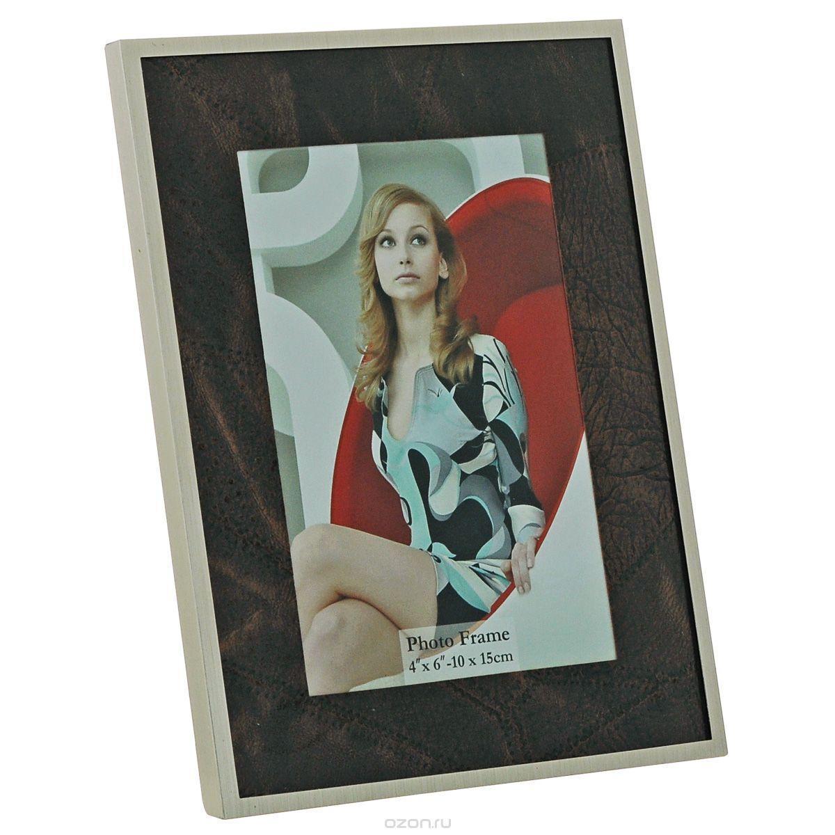 ФоторамкаImage Art 6035-4G12179 WF-019/179Фоторамка Image Art - прекрасный способ красиво оформить ваши фотографии. Изделие рассчитано на 2 фотографии. Фоторамка выполнена из металла и защищена стеклом. Фоторамку можно поставить на стол или подвесить на стену, для чего с задней стороны предусмотрены специальные отверстия. Такая фоторамка поможет сохранить на память самые яркие моменты вашей жизни, а стильный дизайн сделает ее прекрасным дополнением интерьера.