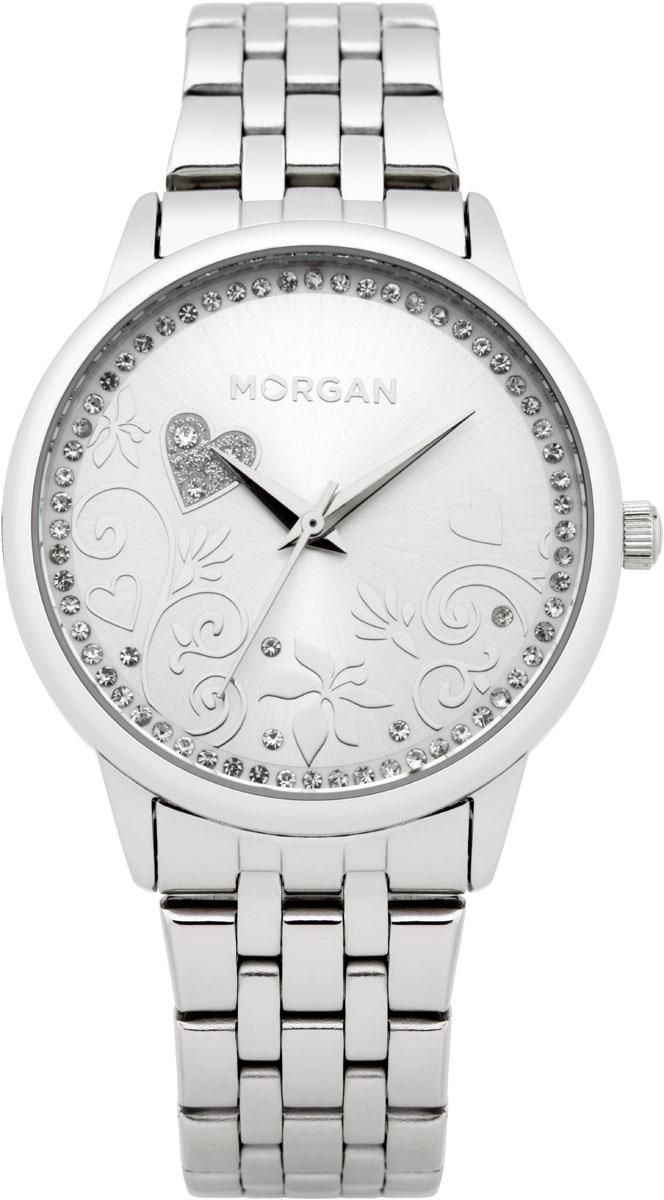 Набор MORGAN: наручные часы, зеркало, цвет: серебристый. M1130SMBRBM8434-58AEНабор MORGAN включающий в себя наручные часы и зеркало.Элегантные наручные часы MORGAN выполнены из нержавеющей стали, минерального стекла и дополнены чешскими кристаллами. Циферблат изделия оформлен цветочным узором, который изящно дополняют кристаллы.Часы оснащены механизмом Miyota с тремя стрелками, устойчивым к царапинам минеральным стеклом, степенью водозащиты 3atm. Изделие дополнено стальным браслетом, который закрывается на застежку-клипсу.Компактное зеркало раскрывается при помощи механизма на защелке, изделие оформлено сердечком из страз.Набор MORGAN поставляется в фирменной упаковке. Стильные часы подчеркнут изящество женской руки и отменное чувство стиля их обладательницы.