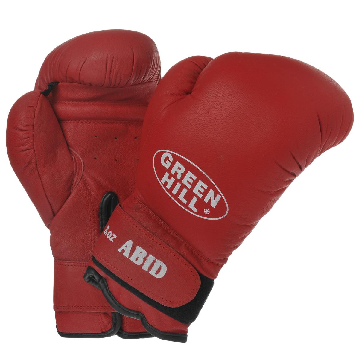 Перчатки боксерские Green Hill Abid, цвет: красный. Вес 8 унцийG-2036312Боксерские тренировочные перчатки Green Hill Abid выполнены из натуральной кожи. Они отлично подойдут для начинающих спортсменов. Мягкий наполнитель из очеса предотвращает любые травмы. Широкий ремень, охватывая запястье, полностью оборачивается вокруг манжеты, благодаря чему создается дополнительная защита лучезапястного сустава от травмирования. Застежка на липучке способствует быстрому и удобному одеванию перчаток, плотно фиксирует перчатки на руке.