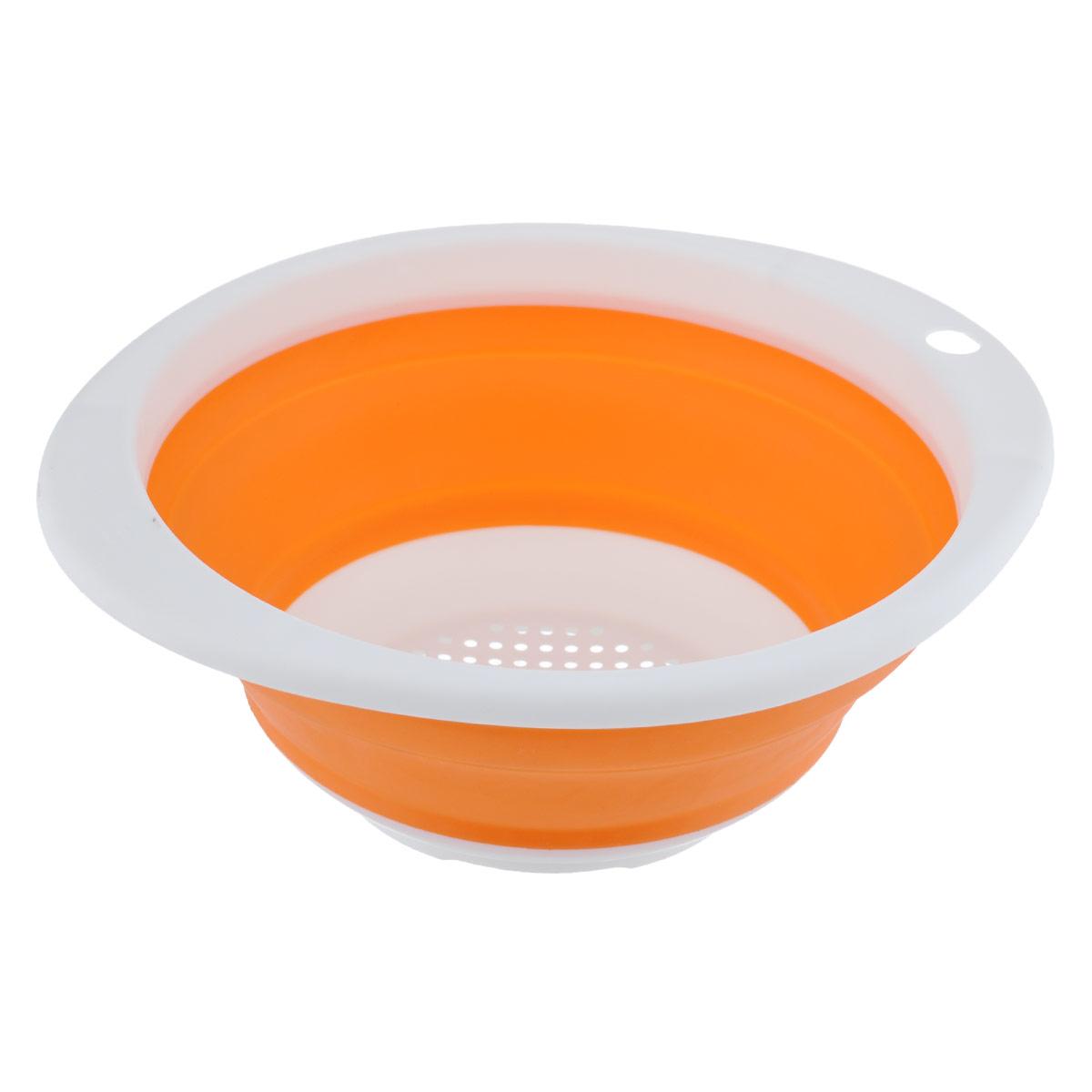 Дуршлаг Идея, складной, цвет: оранжевый. CLD-023534Дуршлаг складной Идея, изготовленный из высококачественного пищевого силикона, станет полезным приобретением для вашей кухни. Он идеально подходит для процеживания, ополаскивания и стекания макарон, овощей, фруктов. Нельзя мыть и сушить в посудомоечной машине.Внутренний диаметр: 18 см.Размер (в разложенном виде): 23 см х 20 см х 9 см.Размер (в сложенном виде): 23 см х 20 см х 3 см.