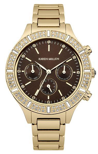 Часы наручные женские Karen Millen, цвет: золотой. KM103GM4106черныеЭлегантные женские часы Karen Millen изготовлены из нержавеющей стали с IP-покрытием и минерального стекла. Циферблат и корпус часов оформлены символикой бренда и кристаллами Swarovski.Корпус изделия оснащен кварцевым механизмом, который имеет степень влагозащиты равную 5 Bar, дополнен устойчивым к царапинам минеральным стеклом. Браслет оснащен замком-бабочкой, который позволит с легкостью снимать и надевать изделие.Часы поставляются в фирменной упаковке.Часы Karen Millen подчеркнут изящность женской руки и отменное чувство стиля у их обладательницы.