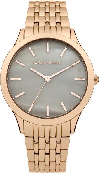 Часы наручные женские Karen Millen, цвет: золотой. KM106ERGM4106черныеЭлегантные женские часы Karen Millen изготовлены из нержавеющей стали с IP-покрытием и минерального стекла. Циферблат часов оформлен символикой бренда, а также перламутровой вставкой.Корпус изделия оснащен кварцевым механизмом, который имеет степень влагозащиты равную 5 Bar, дополнен устойчивым к царапинам минеральным стеклом. Браслет оснащен замком-клипсой, который позволит с легкостью снимать и надевать изделие.Часы поставляются в фирменной упаковке.Часы Karen Millen подчеркнут изящность женской руки и отменное чувство стиля у их обладательницы.