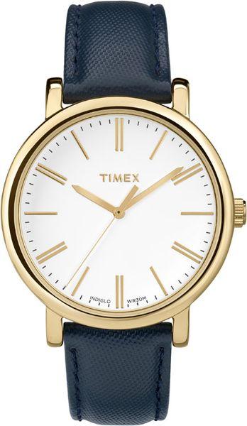 Часы наручные женские Timex, цвет: золотистый, синий. TW2P63400EQW-M710DB-1A1Стильные женские наручные часы Timex выполнены из нержавеющей стали с золотистым покрытием. Циферблат изделия оформлен отметками, часовой, минутной и секундной стрелками. Также циферблат дополнен логотипом Timex.Часы оснащены кварцевым механизмом, устойчивым к царапинам минеральным стеклом и подсветкой циферблата Indiglo.Модель обладает степенью влагозащиты 3 atm. Изделие дополнено ремешком из натуральной с тиснением, позволяющим максимально комфортно и быстро снимать и одевать часы при помощи пряжки. Часы поставляются на специальной подушечке в стильной коробке с логотипом Timex. Стильные часы станут отличным дополнением к вашему образу.