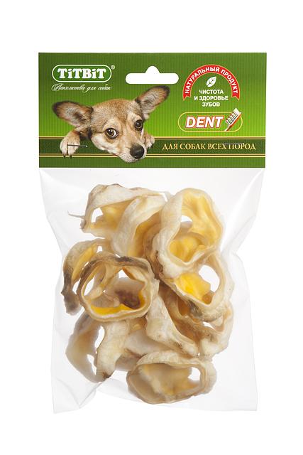 Лакомство для собак Titbit, говяжьи ракушки0120710Упаковка содержитвысушенные хрящевые основанияговяжьихушей. Высокое содержание коллагеновых и эластиновых волокон обеспечивает поступление в организм незаменимых компонентов для роста и поддержания качества хрящевой ткани суставов вашего питомца. Рекомендованос цельюоблегчения смены зубов у щенков, укрепления десен, очистки зубов от пищевого налета и зубного камня, дополнительного питания и укрепления хрящевой ткани собак среднего и старшего возраста. Высокое содержание коллагена и эластина способствует улучшению формирования ушного хряща для пород собак, стандартом которых предусмотрен вертикальный постав ушной раковины.Состав: Высушенное ухо говяжье.