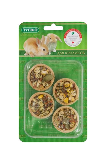 Лакомтсво для кроликов Titbit, тарталетки с морковью и тыквой, 4 шт0120710Тарталетки представляют собой корзиночки из хрустящего пресного теста с лакомой и полезной для грызунов начинкой. Обогащают ежедневный рацион витаминами, макро – и микроэлементами. Продукт не содержит искусственных красителей и ароматизаторов. Входящая в состав продукта морковь богата витаминами груполипропиленовый пакеты В, содержит важнейшие для организма животного никотиновую и фолиевую кислоты. Обладает противовоспалительным и мочегонным действием. Тыква очень вкусный и полезный овощ, который содержит большое количество каротина и витаминов, легко усваивается даже ослабленным организмом. Состав: Мука 1 сорта, морковь, тыква, яблоко, кукуруза, кунжут, крапива, семена тыквы. Полезные вещества: сбалансированный витаминно-минеральный комплекс.