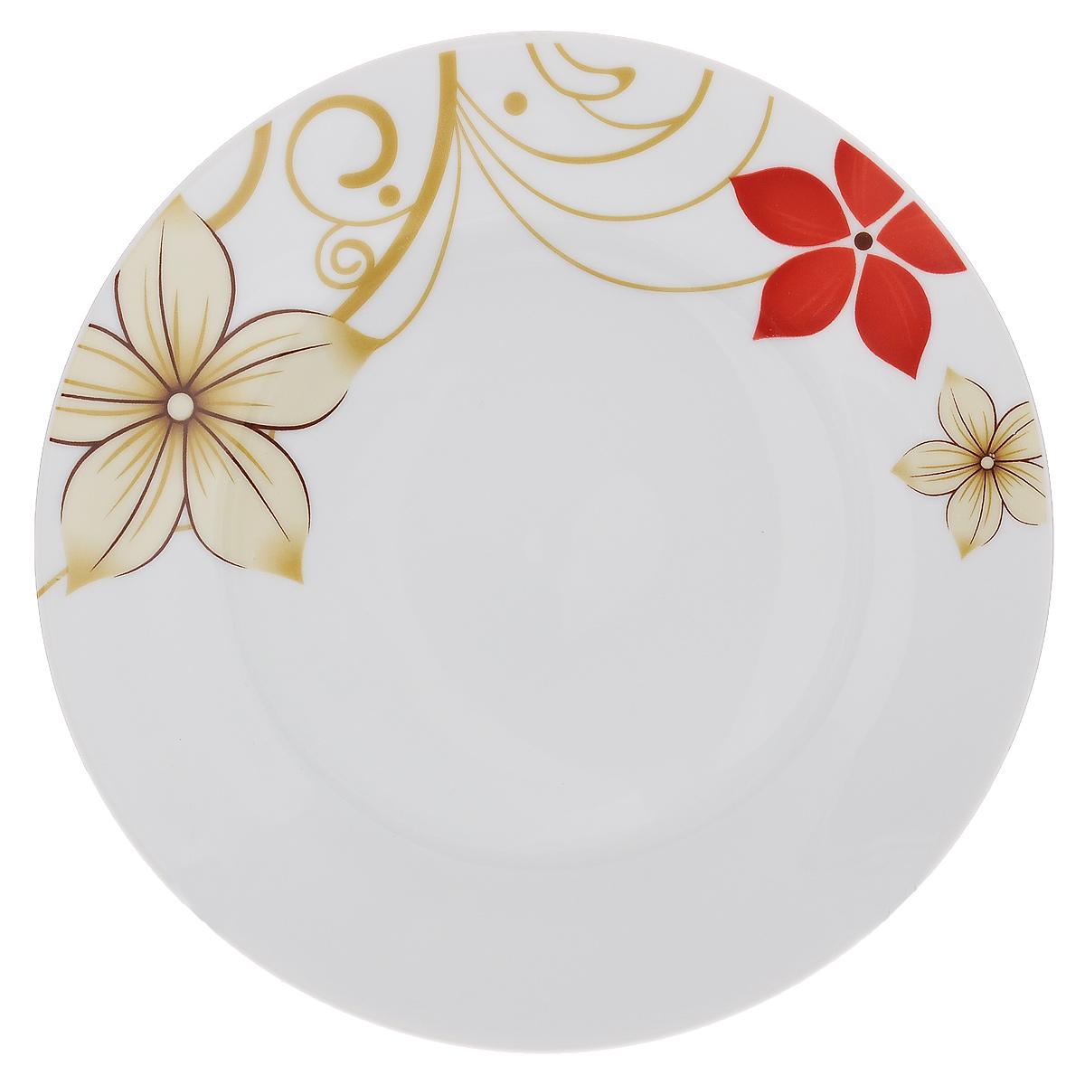 Тарелка для горячего Магнолия, диаметр 23 см54 009312Тарелка Магнолия изготовлена из высококачественного фаянса, покрытого слоем сверкающей глазури. Предназначена для подачи вторых блюд. Изделие декорировано красочным цветочным рисунком. Такая тарелка украсит сервировку стола и подчеркнет прекрасный вкус хозяйки.Можно мыть в посудомоечной машине и использовать в СВЧ. Диаметр тарелки: 23 см.
