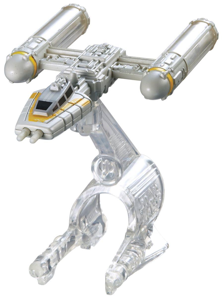 """Звездный корабль Hot Wheels """"Y-Wing Fighter Gold Leader"""" непременно приведет в восторг поклонника фантастической саги """"Звездные воины"""". В комплекте звездный корабль и подставка. Надевайте на руку устройство Flight Navigator и запускайте корабль в полет по комнате, прямо как в гиперпространстве, или устраивайте яростные космические сражения. Flight Navigator можно также использовать как подставку для игрушек. Звездолеты совместимы с игровыми наборами Hot Wheels Star Wars (продаются отдельно)."""