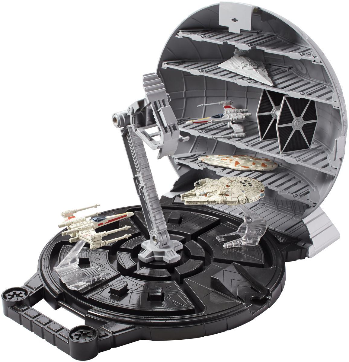 """Игровой набор Star Wars """"Звезда Смерти"""" не оставит вашего ребенка равнодушным! """"Звезда Смерти"""" выполнена в виде полукруглого чемоданчика на устойчивой платформе и с удобной ручкой. В чемоданчике есть 5 отсеков, где можно разместить около 10 звездолетов. Внутри оборудован кран для перемещения звездолетов между отделениями и два трамплина для машинок. С таким чемоданчиком не только интересно играть, но и удобно хранить звездолеты и другие атрибуты Звездных войн. Игрушка выполнена из прочного безопасного пластика с высокой точностью детализации даже самых мелких частей. Создай свой галактический флот Звездных войн и восстанови самые эпичные сражения из нового эпизода саги. Ребенок сможет часами играть с этим набором, придумывая разные истории. Порадуйте его таким замечательным подарком! Звездолеты в комплект не входят."""