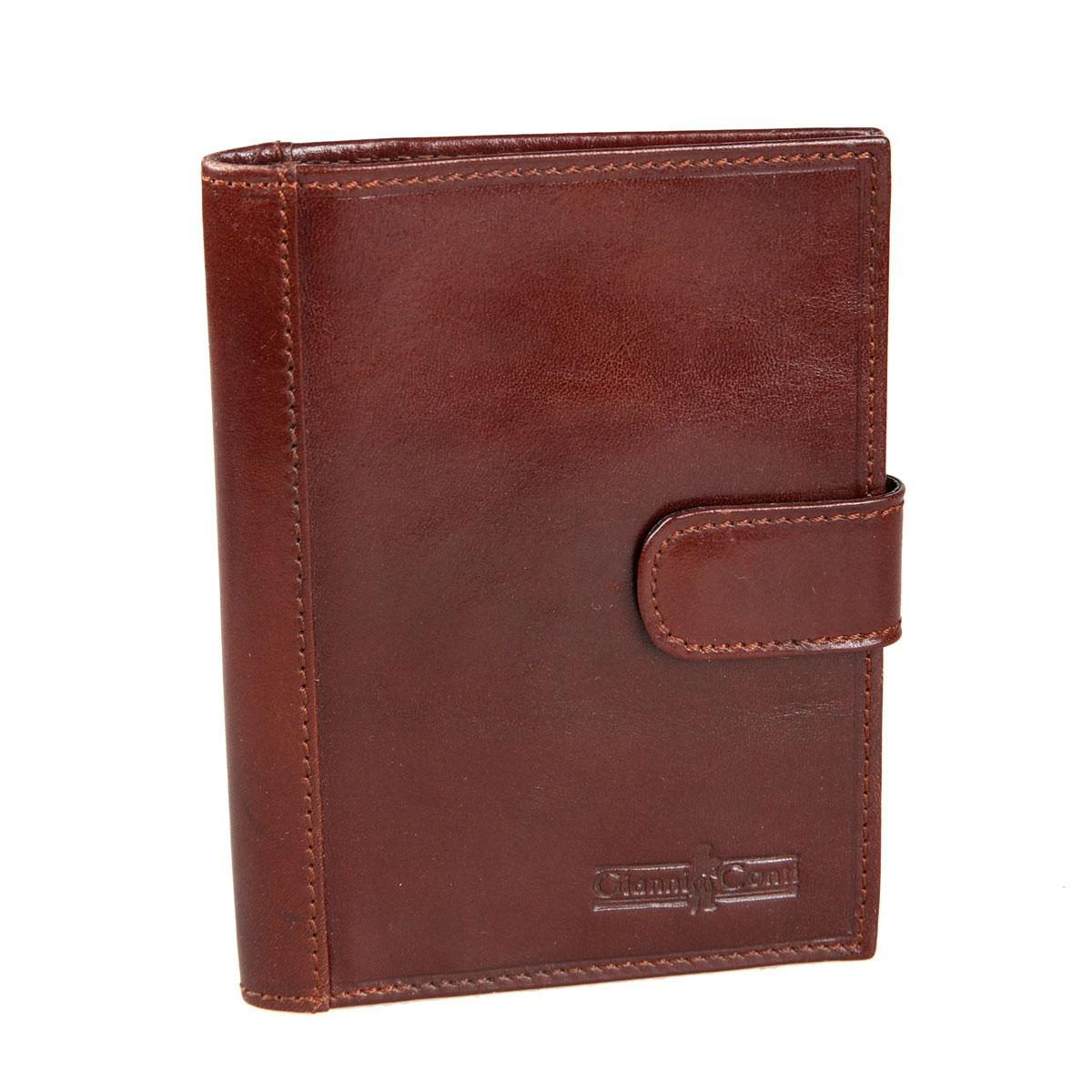 Обложка для паспорта мужская Gianni Conti, цвет: коричневый. 907035907035 brownСтильная обложка Gianni Conti выполнена из натуральной кожи и оформлена тиснением в виде названия бренда. На внутреннем развороте справа расположено шесть кармашков для пластиковых карт и визиток, потайной карман и карман для документов. Закрывается изделие с помощью хлястика с кнопкой.Обложка упакована в подарочную картонную коробку. Такая обложка не только поможет сохранить внешний вид ваших документов и защитит их от повреждений, но и станет стильным аксессуаром, который подчеркнет ваш образ.