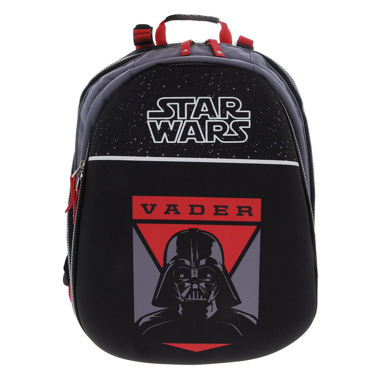 Рюкзак Star Wars Vader, цвет: черный, красный. 3747472523WDРюкзак Star Wars Vader будет отличным подарком поклонникам вселенной Star Wars! Рюкзак выполнен из полиэстера черного и красного цветов и оформлен оригинальным рисунком с изображением Темного Лорда Дарта Вейдера. Рюкзак оснащен одним основным отделением, закрывающимся на застежку-молнию. На внешней стороне расположен вместительный накладной карман на застежке-молнии, содержащий шесть накладных кармашков, а также два кармашка для ручек и карандашей. Рюкзак оснащен мягкими плечевыми лямками, мягкой спинкой с сетчатой поверхностью и текстильной ручкой для удобной переноски.