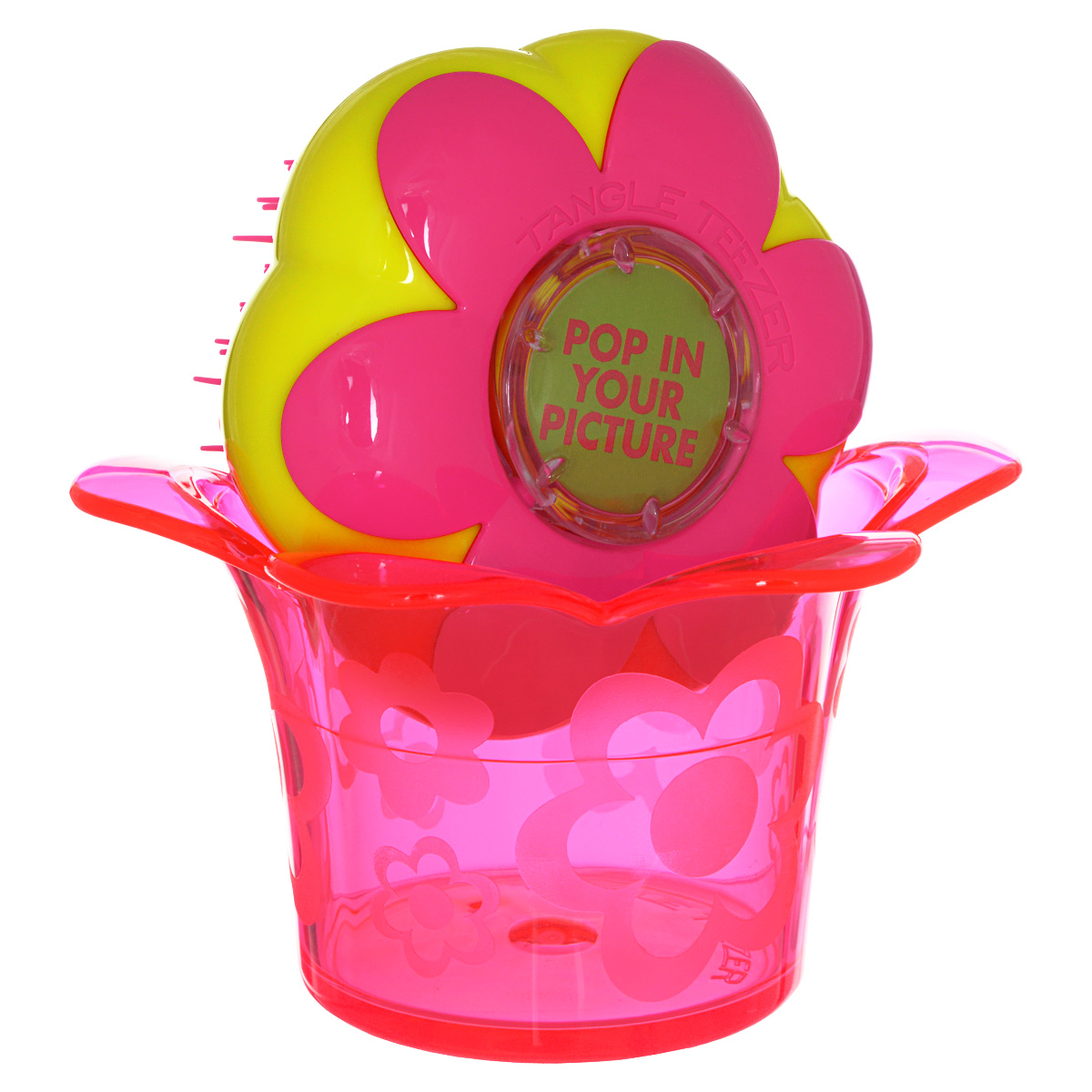 Tangle Teezer Расческа для волос Magic Flowerpot. Princess PinkAC-2233_серыйДетская распутывающая чудо-расческа Tangle Teezer Magic Flowerpot Princess Pink идеально подходит для всех типов волос. Оригинальная форма зубчиков обеспечивает двойное действие и позволяет быстро и безболезненно расчесать влажные и сухие волосы, не нарушая структуру детских волос. Подходит детям от 3-х лет. Благодаря эргономичному дизайну, расческу удобно держать в руках, не опасаясь выскальзывания. Расческа дополнена оригинальной подставкой, в которой можно хранить различные резиночки и заколочки. Товар сертифицирован.