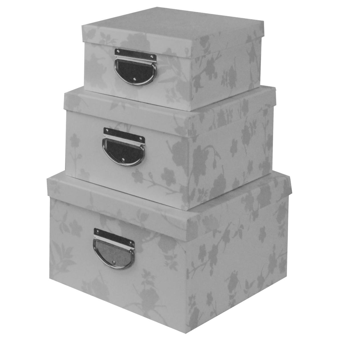 Набор коробок для хранения Зимнее настроение, цвет: белый, 3 шт12723Кофры для хранения Зимнее настроение прекрасно подойдут для гардероба, хранения личных вещей, нижнего белья, различных аксессуаров, а также бытовых предметов или принадлежностей для шитья. В комплекте 3 прямоугольных кофра разного размера, с крышками. Изделия выполнены из плотного картона, внешняя поверхность оформлена растительным орнаментом с бархатистой текстурой. Сбоку имеется металлическая ручка, которая позволяет использовать их в качестве выдвижных ящиков. Размер малого кофра:25 см х 20 см х 10 см. Размер среднего кофра: 30 см х 23 см х 13 см. Размер большого кофра: 35 см х 26 см х 16 см.