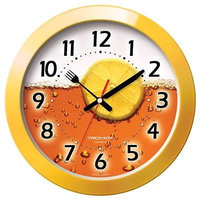 Часы настенные Troyka, цвет: желтый. 11150132300074_ежевикаНастенные кварцевые часы Troyka с изображением чая с лимоном, изготовленные из пластика, прекрасно подойдут под интерьер вашего дома. Круглые часы имеют три стрелки: часовую, минутную и секундную, циферблат защищен прозрачным пластиком. Стрелки выполнены в виде ножа и вилки.Диаметр часов: 29 см.Часы работают от 1 батарейки типа АА напряжением 1,5 В. Внимание! Часы укомплектованы бесплатным тестовым элементом питания для обеспечения их работоспособности при предпродажной подготовке и демонстрации рабочих функций.