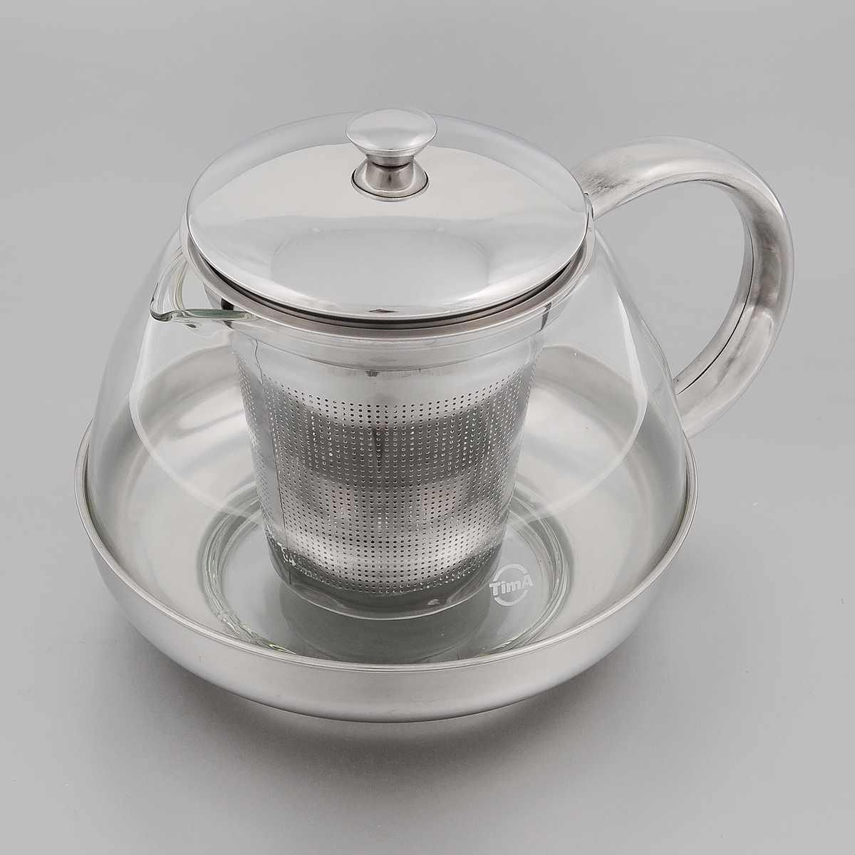 Чайник заварочный TimA Лотос, 1 л115510Заварочный чайник TimA Лотос изготовлен из термостойкого боросиликатного стекла - прочного износостойкого материала. Чайник оснащен фильтром, крышкой, основанием и ручкой из нержавеющей стали.Простой и удобный чайник поможет вам приготовить крепкий, ароматный чай. Дизайн изделия создает гипнотическую атмосферу через сочетание полупрозрачного цвета и хромированных элементов. Можно мыть в посудомоечной машине. Не использовать в микроволновой печи.Диаметр (по верхнему краю): 8,5 см.Высота (без учета крышки): 9,5 см.Высота фильтра: 8,7 см.