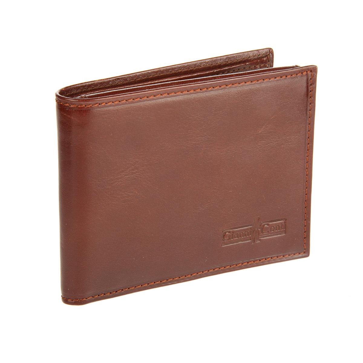 Портмоне мужское Gianni Conti, цвет: коричневый. 907022BM8434-58AEСтильное мужское портмоне Gianni Conti выполнено из натуральной кожи. Лицевая сторона оформлена тиснением в виде названия бренда производителя.Изделие раскладывается пополам. Внутри имеется два отделения для купюр, четыре потайных кармана, карман для мелочи на кнопке, три кармашка для визиток и пластиковых карт, два сетчатых кармана и карман для документов. Портмоне упаковано в фирменную картонную коробку. Оригинальное портмоне подчеркнет вашу индивидуальность и изысканный вкус, а также станет замечательным подарком человеку, ценящему качественные и практичные вещи.