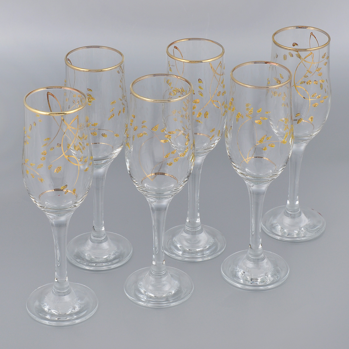 Набор бокалов Гусь-Хрустальный Колосок, 200 мл, 6 штVT-1520(SR)Набор Гусь-Хрустальный Колосок состоит из 6 бокалов на длинных тонких ножках, изготовленных из высококачественного натрий-кальций-силикатного стекла. Изделия оформлены золотистой эмалью и красивым рельефным рисунком. Бокалы предназначены для шампанского или вина. Такой набор прекрасно дополнит праздничный стол и станет желанным подарком в любом доме. Разрешается мыть в посудомоечной машине. Диаметр бокала (по верхнему краю): 5 см. Высота бокала: 20,5 см.