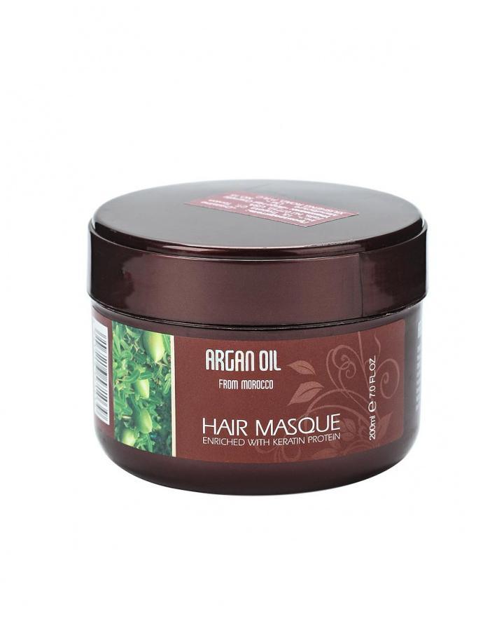 Morocco Argan Oil Маска для волос восстанавливающая с маслом арганы и кератином,200 мл.19003Профессиональная маска для ухода за волосами с драгоценным маслом арганы и протеинами кератина обеспечивает волосам силу и восстановление по всей длине, улучшает их качество и внешний вид, делает их блестящими и густыми.Активные ингредиенты и их эффект: Протеины и аминокислоты кератина проникают вглубь волоса, буквально соединяя разрозненные чешуйки волоса, быстро и заметно восстанавливая его. Благодаря кератину волосы быстро и заметно улучшаются, становятся менее хрупкими и ломкими. Масло арганы, являясь ценнейшим компонентом растительного происхождения, идеально подходит для ухода за волосами. Масло обеспечивает надежную защиту, дарит волосам блеск, укрепляет и восстанавливает их по всей длине. Экстракт алоэ увлажняет и препятствует потере влаги, одновременно насыщая волосы необходимыми питательными веществами, делая их более сильными и крепкими. Экстракт корня алтея питает корни, способствуя росту крепких и здоровых волос. Восстанавливает волосы и придает им мягкость и гладкость. Экстракт плюща, помимо стимуляции роста волос, великолепно увлажняет и сохраняет влагу, создавая на поверхности волоса тончайшую невесомую защиту. Экстракт розмарина нормализует салоотделение, замедляет выпадение и стимулирует рост волос, а также укрепляет структуру поврежденных волос и придает им здоровый блеск. Экстракт водяного кресса является источником витаминов, антиоксидантов и микроэлементов, необходимых для роста крепких и сильных волос. Оказывает выраженное увлажняющее действие, восстанавливает структуру волос. Коллаген обеспечивает великолепную защиту от повреждения внешними факторами, окутывая поверхность волоса воздухопроницаемой защитой, придает блеск и шелковистую гладкость волосам. Восстанавливает и укрепляет волосы и от корней до самых кончиков.После использования маски для восстановления волос Argan Oil from Morocco Вы отметите уменьшение количества секущихся кончиков, оцените зд