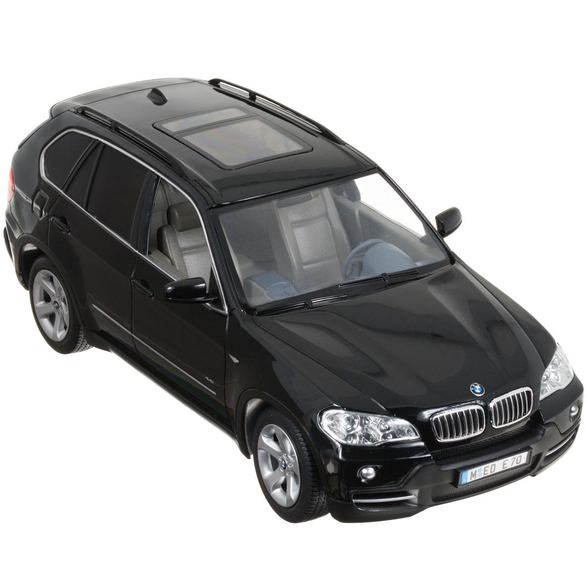 """Радиоуправляемая модель Rastar """"BMW X5"""" обязательно привлечет внимание взрослого и ребенка и понравится любому, кто увлекается автомобилями. Маневренная и реалистичная уменьшенная копия выполнена в точной детализации с настоящим автомобилем в масштабе 1:14. Управление машинкой происходит с помощью пульта. Машина двигается вперед и назад, поворачивает направо, налево и останавливается. Имеются световые эффекты (загораются фары и стоп-сигналы). Колеса игрушки обеспечивают плавный ход, машинка не портит напольное покрытие. Радиоуправляемые игрушки способствуют развитию координации движений, моторики и ловкости. Ваш ребенок часами будет играть с моделью, придумывая различные истории и устраивая соревнования. Порадуйте его таким замечательным подарком! Машина работает от 5 батареек напряжением 1,5V типа АА (не входят в комплект). Пульт работает от батарейки 9V типа """"Крона"""" (не входит в комплект)."""
