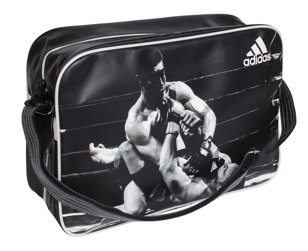 Сумка спортивная Adidas Sports Bag MMA, цвет: черный, белый. Размер L378233/01-01Спортивная сумка Adidas Sports Bag MMA изготовлена из искусственной кожи. Лицевая сторона сумки оформлена оригинальным принтом. Она предназначена для переноски и хранения спортивного инвентаря и других нужных для занятия спортом предметов. Сумка состоит из 1 большого отделения. Имеет удобный плечевой ремень.