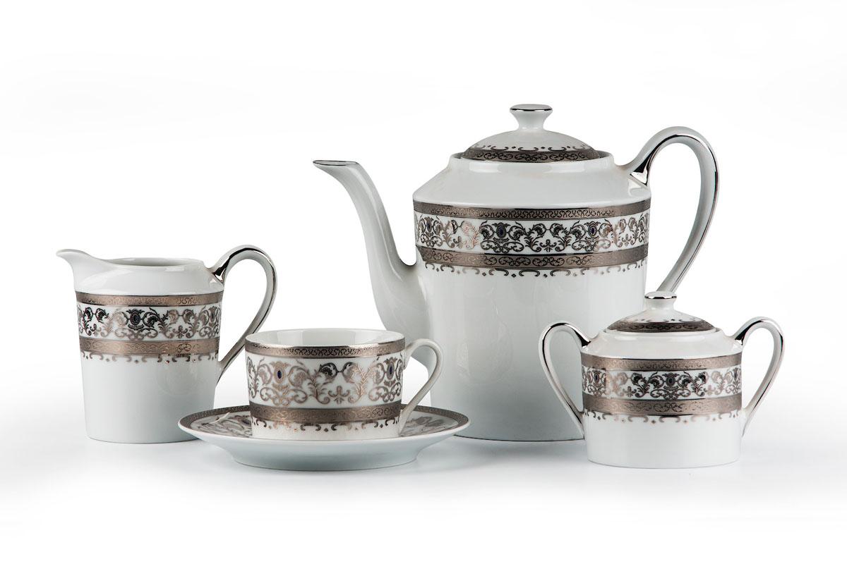Mimosa 1647, сервиз чайный 15 предметов, цвет: белый с платинойVT-1520(SR)Чайник 1,2л, сахарница 250мл, молочник 300мл, чайная пара 220 мл *6 штук . Фарфор фабрики Tunisie Porcelaine, производится в Тунисе из знаменитой своим качеством и белизной глины, добываемой во французской провинции Лимож.Преимущества этого фарфора заключаются в устойчивости к сколам и трещинам, что возможно благодаря двойному термическому обжигу. Европейский дизайн, декор и формы обеспечиваются за счет тесного сотрудничества фабрики с ведущими мировыми дизайн-бюро такими как: Nelly Reynal, Yves De la Rosiere, Sarah Anderson, Heracles. Материал: фарфор: цвет: белый с платинойСерия: Prague Platine