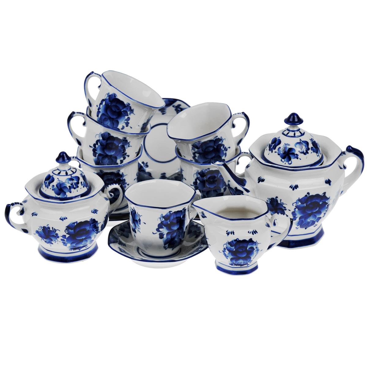 Сервиз чайный Граненый, цвет: белый, синий, 15 предметов115510Сервиз чайный Граненый выполнен из керамики и состоит из шести чашек, шести блюдец, чайника, молочника и сахарницы. Предметы набора оформлены росписью в технике гжель.Изящный дизайн придется по вкусу и ценителям классики, и тем, кто предпочитает утонченность и изысканность. Он настроит на позитивный лад и подарит хорошее настроение с самого утра.Оригинальный дизайн сервиза позволит украсить любую кухню, внеся разнообразие как в строгий классический стиль, так и в современный кухонный интерьер.Количество чашек: 6 шт. Диаметр чашек по верхнему краю: 10 см.Высота чашек: 9 см.Объем чашек: 300 мл. Количество блюдец: 6 шт.Диаметр блюдец: 14,5 см.Высота блюдец: 3 см.Высота сахарницы (с учетом крышки): 17,5 см.Диаметр сахарницы по верхнему краю: 11 см. Высота чайника (с учетом крышки): 21 см.Диаметр чайника по верхнему краю: 12,5 см. Объем чайника: 900 мл. Высота молочника (с учетом носика): 9,5 см. Объем молочника: 300 мл. Диаметр дна молочника: 6 см.
