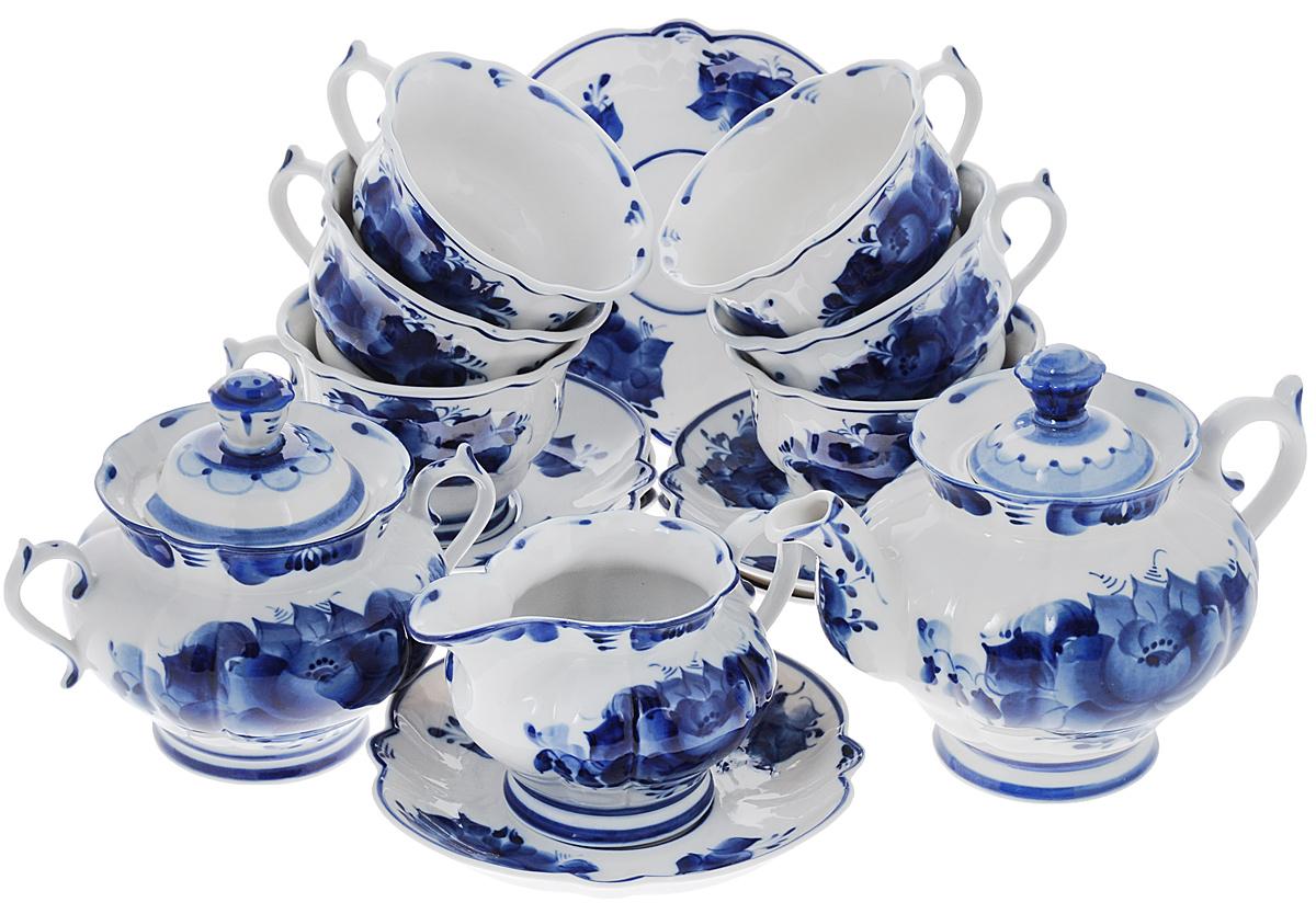 Сервиз чайный Орхидея, 15 предметов21395599Чайный сервиз Орхидея состоит из 6 чашек, 6 блюдец, молочника, заварочного чайника и сахарницы. Предметы набора изготовлены из высококачественной керамики и оформлены гжельской росписью. Изящный дизайн придется по вкусу и ценителям классики, и тем, кто предпочитает утонченность и изысканность. Он настроит на праздничный лад и подарит хорошее настроение с самого утра. Чайный набор - идеальный и необходимый подарок для вашего дома и для ваших друзей в праздники, юбилеи и торжества! Он также станет отличным корпоративным подарком и украшением любой кухни. Уважаемые клиенты!Обращаем ваше внимание, что роспись на изделиях сделана вручную. Рисунок может немного отличаться от изображения на фотографии. Объем чашки: 200 мл.Диаметр чашки (по верхнему краю): 10 см.Высота чашки: 7,5 см.Диаметр блюдца: 16 см.Объем чайника: 650 мл.Диаметр чайника (по верхнему краю): 5,5 см.Высота чайника (без учета крышки): 11,5 см.Объем сахарницы: 450 мл. Диаметр сахарницы (по верхнему краю): 6 см.Высота сахарницы (без учета крышки): 10 см.Размер молочника: 15 см х 9 см х 8,5 см.