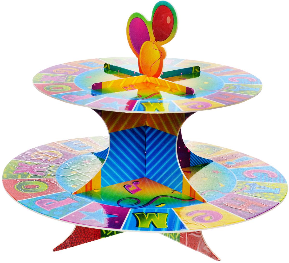 """Стойка для кексов Веселая затея """"С днем рождения: Мозаика"""" - это удобная, изящная подставка для праздничного угощения. Стойка украшена красочным мозаичным изображением с надписью """"С днем рождения!"""". Она легко собирается, не требует склеивания. Для экономии места упакована в разобранном виде в пакете. Двухъярусная стойка позволяет осуществить красивую выкладку кексов. Стойка для кексов Веселая затея """"С днем рождения: Мозаика"""" станет настоящим украшением праздничного стола! Высота стойки в собранном виде - 21 см, диаметр нижнего яруса - 25,5 см, диаметр верхнего яруса - 20 см."""