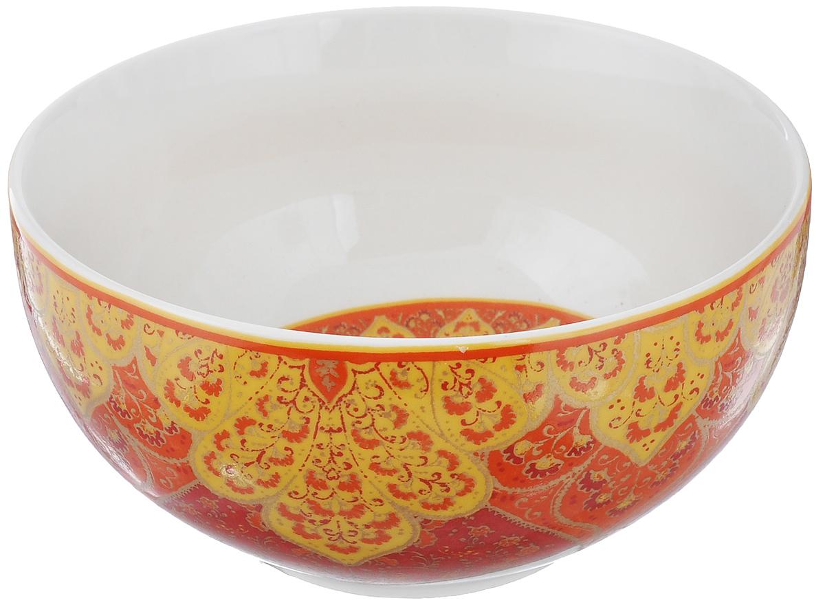 Салатница Utana Кашан Рэд, цвет: белый, красный, оранжевый, диаметр 14 см115510Салатница Utana Кашан Рэд изготовлена из высококачественной керамики. Внешняя стенка и дно украшены изысканным узором. Такая салатница прекрасно подходит для холодных и горячих блюд: каш, хлопьев,супов, салатов. Она дополнит коллекцию вашей кухонной посуды и будет служитьдолгие годы. Яркая салатница станет украшением вашего стола и прекрасно подойдет дляиспользования, как дома, так и на даче или пикниках.Можно использовать в микроволновой печи и посудомоечной машине. Диаметр салатницы по верхнему краю: 14 см. Высота стенки: 6,5 см.