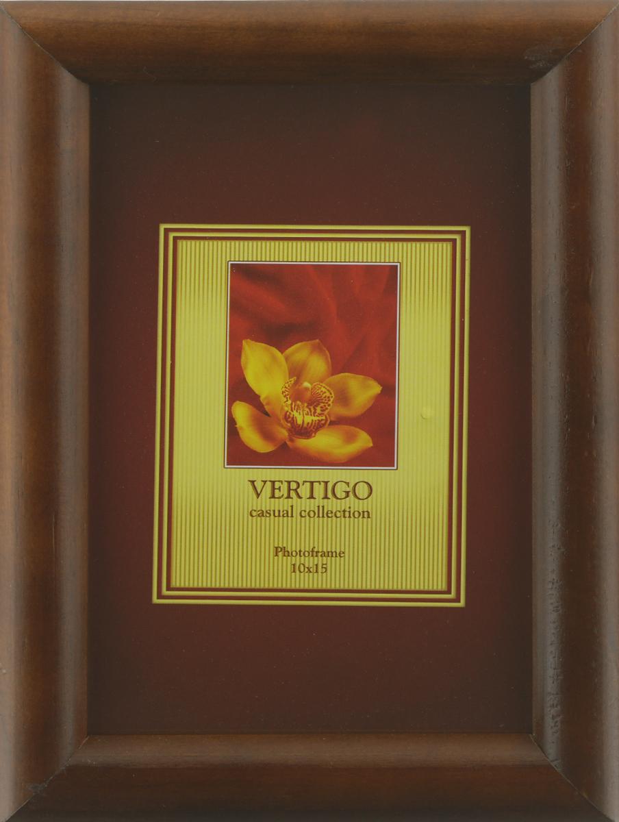Фоторамка Vertigo Toscana, цвет: темно-коричневый, 10 х 15 см12194 WF-022/194Фоторамка Vertigo Toscana выполнена из дерева и стекла, защищающего фотографию. Оборотная сторона рамки оснащена специальной ножкой, благодаря которой ее можно поставить на стол или любое другое место в доме или офисе. Также изделие оснащено специальными отверстиями для подвешивания на стену.Такая фоторамка поможет вам оригинально и стильно дополнить интерьер помещения, а также позволит сохранить память о дорогих вам людях и интересных событиях вашей жизни.