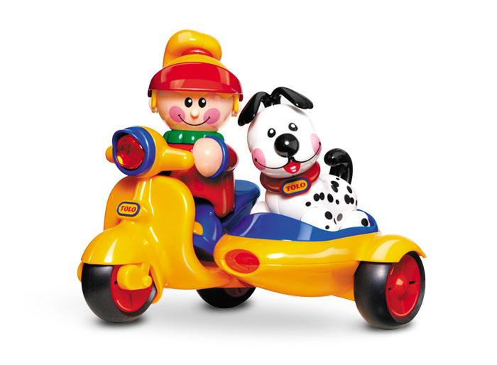 Замечательный мотоцикл с коляской. В набор входят фигурка девочки и щенок. Поощряет взаимодействие и развивает фантазию. Крепкий и прочный. Эта игрушка развивает следующие навыки: