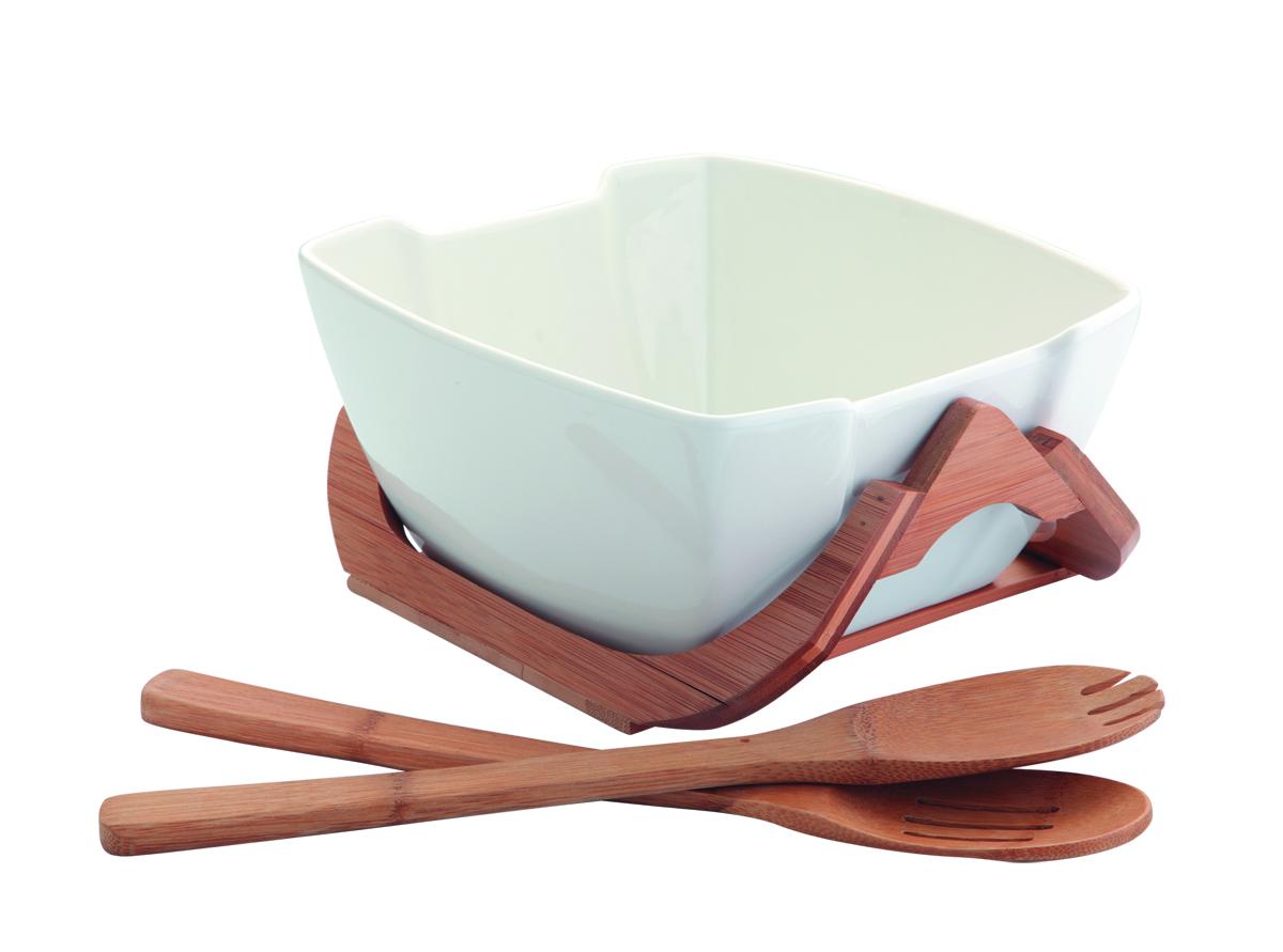 Салатник Augustin Welz, цвет: белый, 1,98 л54 009312Салатник Augustin Welz выполнена из фарфора и дополнена бамбуковыми подставкой, а так же сервировочной парой из дерева. Он создаст комфорт и уют на кухне и идеально подойдет для большой семьи. Изделие подходит как для повседневного домашнего использования, так и для профессиональной сервировки стола и станет прекрасным подарком к любому празднику.Объем салатника: 1980 мл,Размер салатника по верхнему краю: 23 см х 21 см. Размер подставки: 24 см х 21 см х 10,5 см.Длина сервировочной пары (деревянные ложка и вилка): 25 см.