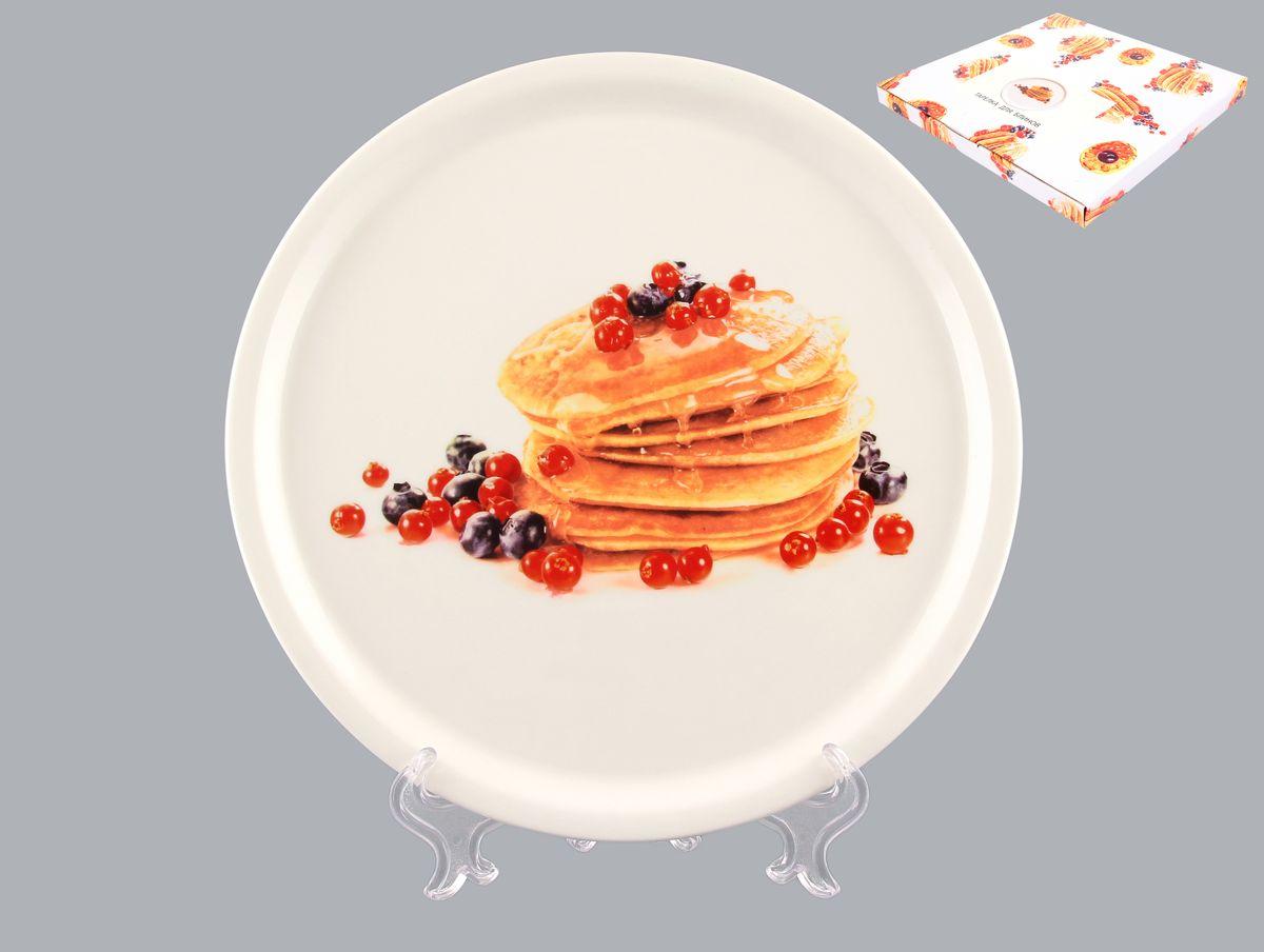 Тарелка для блинов Elan Gallery Блины с ягодами, диаметр 25 смVT-1520(SR)Круглая тарелка Elan Gallery Блины с ягодами, изготовленная из керамики и декорированная ярким и аппетитным изображением, позволит красиво подать блины. Такая тарелка украсит сервировку вашего стола и подчеркнет прекрасный вкус хозяина, а также станет отличным подарком. Диаметр: 25 см. Высота: 2 см.