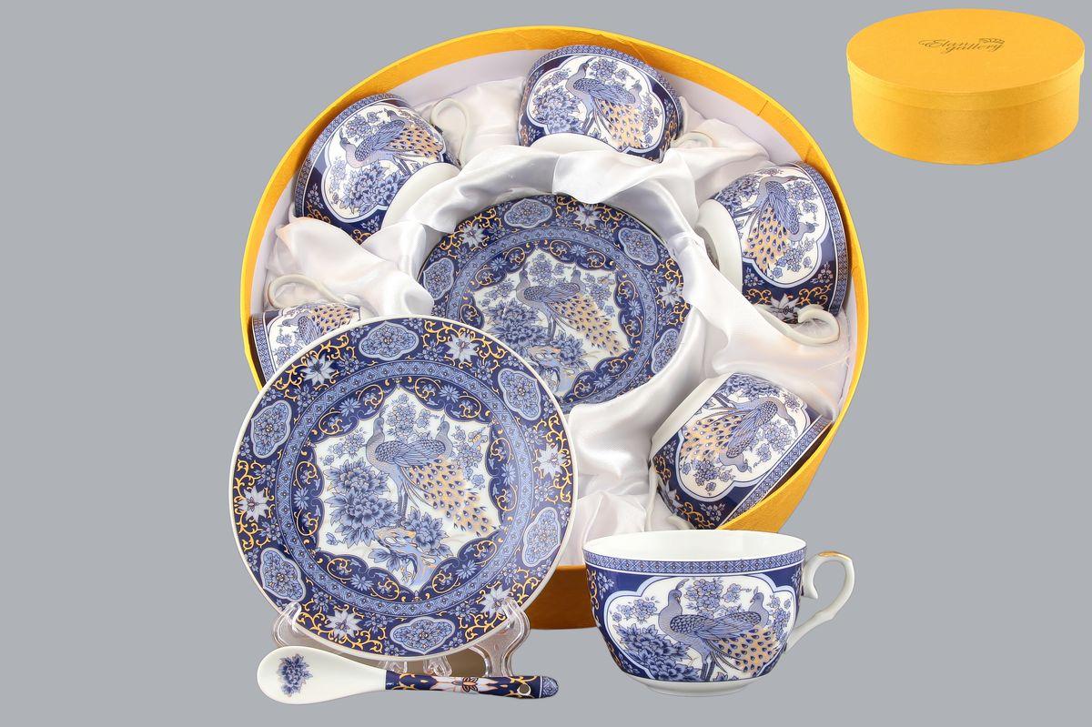 Набор чайный Elan Gallery Павлин синий, 18 предметовVT-1520(SR)Чайный набор Elan Gallery Павлин синий состоит из 6 чашек, 6 блюдец и 6 ложек. Изделия, выполненные из высококачественной керамики, имеют элегантный дизайн и классическую форму.Такой набор прекрасно подойдет как для повседневного использования, так и дляпраздников. Чайный набор Elan Gallery Павлин синий - это не только яркий и полезный подарок для родных и близких, это также великолепное дизайнерское решение для вашей кухни или столовой. Не использовать в микроволновой печи.Объем чашки: 250 мл. Диаметр чашки (по верхнему краю): 9,5 см. Высота чашки: 6 см.Диаметр блюдца (по верхнему краю): 14 см.Высота блюдца: 2 см.Длина ложки: 12,5 см.