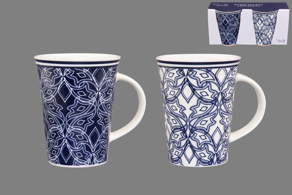 Набор кружек Elan Gallery Изящный узор, цвет: белый, синий, 320 мл, 2 шт54 009312Набор Elan Gallery Изящный узор состоит из двух кружек, выполненных из керамики.Этот необычный набор станет великолепным подарком для каждого и, несомненно, вызовет восхищение. Объем кружек: 320 мл. Диаметр кружек (по верхнему краю): 8,5 см. Высота кружек: 11 см.Не рекомендуется применять абразивные моющие средства. Не использовать в микроволновой печи.