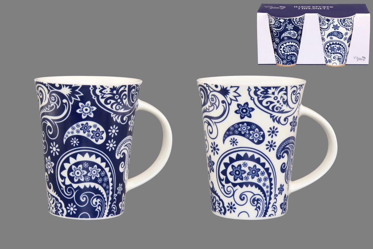 Набор кружек Elan Gallery Пейсли, цвет: белый, синий, 320 мл, 2 шт115510Набор Elan Gallery Пейсли состоит из двух кружек, выполненных из керамики.Этот необычный набор станет великолепным подарком для каждого и, несомненно, вызовет восхищение. Объем кружек: 320 мл. Диаметр кружек (по верхнему краю): 8,5 см. Высота кружек: 11 см.Не рекомендуется применять абразивные моющие средства. Не использовать в микроволновой печи.